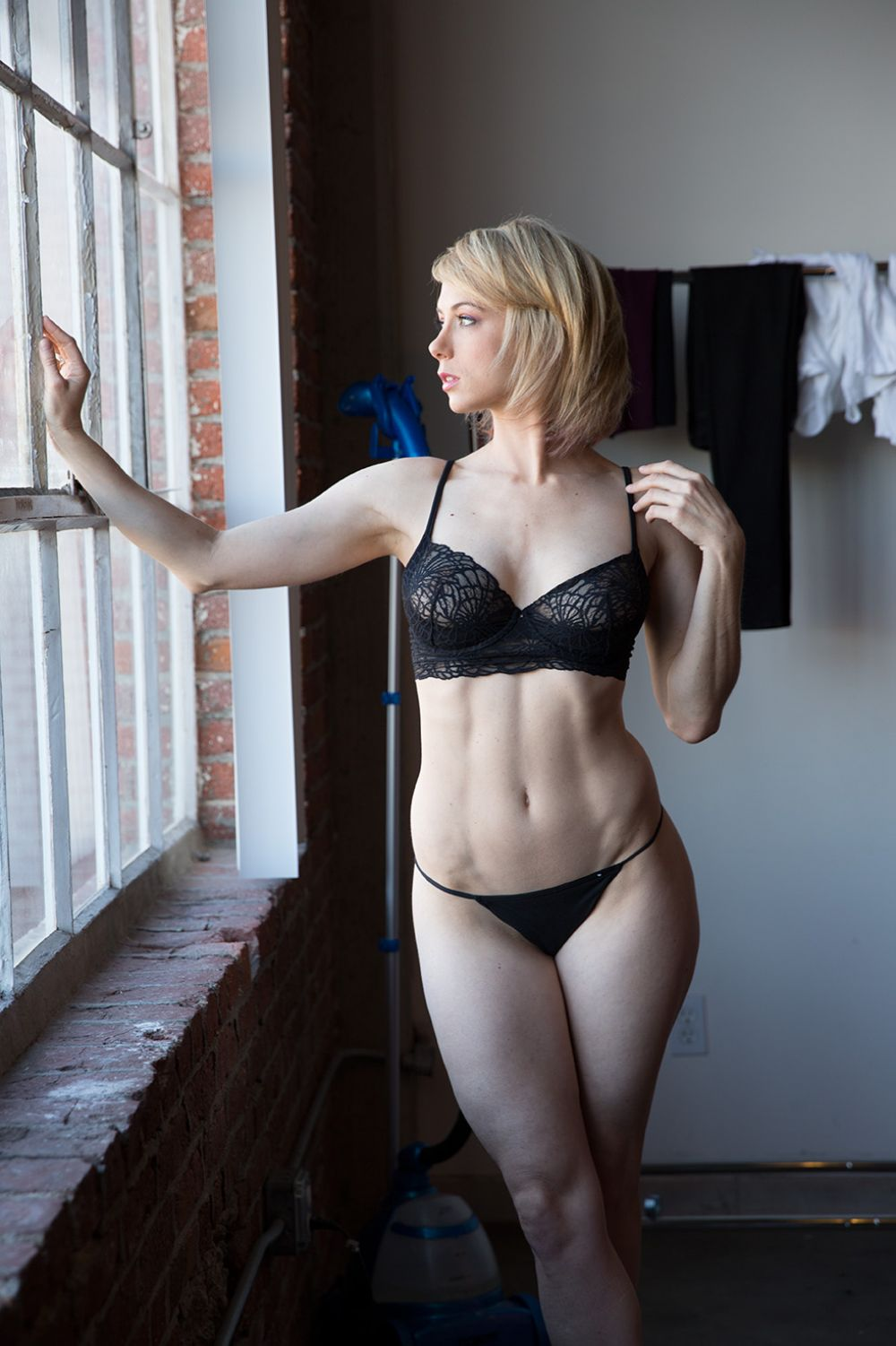 ILIZA SHLESINGER on the Set of a Photoshoot