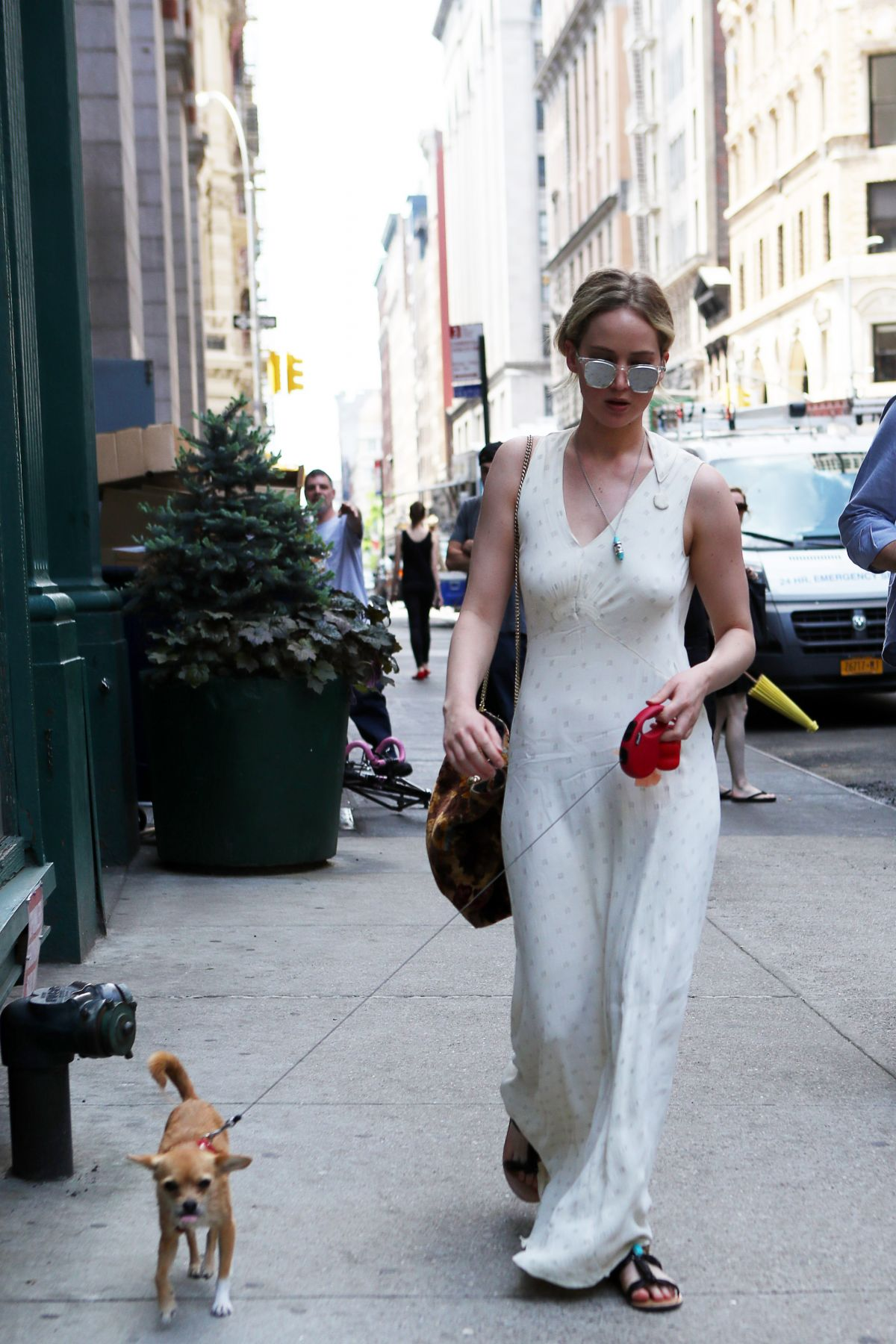 JENNIFER LAWRENCE Walks Her Dog Out in New York 05/19/2017