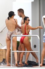 KENDALL JENNER and KOURTNEY KARDASHIAN in Swimsuits at a Yacht in Cannes 05/22/2017