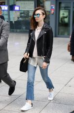 LILY COLLINS Arrives at Heathrow Airport in London 05/23/2017