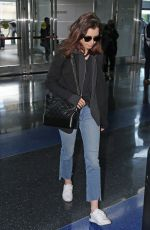 LILY COLLINS in Jeans at JFK Airport in New York 05/03/2017