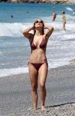 MICHELLE HUNZIKER in Bikini on the Beach in Varigotti 05/21/2017