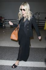 MOLLY SIMS at LAX Airport in Los Angeles 05/17/2017