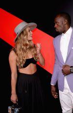 NINA AGDAL at G.H. Mumm and Usain Bolt