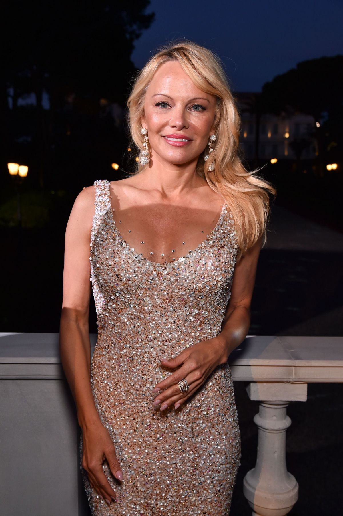 PAMELA ANDERSON at Love on the Rocks Photocall Party at ... Pamela Anderson