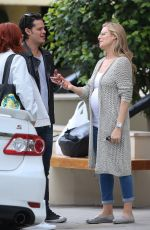 Pregnant ABI TITMUSS and Ari Welkom Share a Kiss Out in Los Angeles 05/28/2017