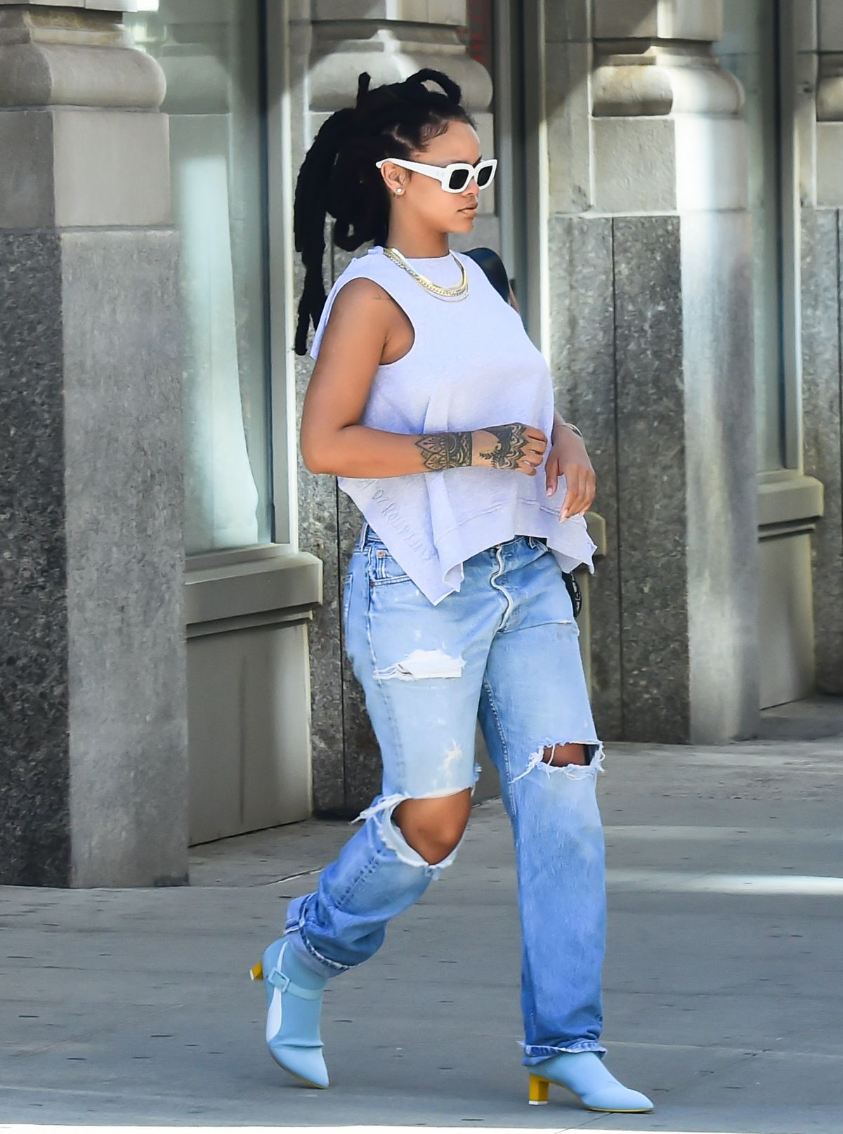 RIHANNA in Ripped Jeand Out in New York 05/04/2017