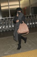 VANESSA HUDGENS Covers Her Face Out in Los Angeles 05/09/2017