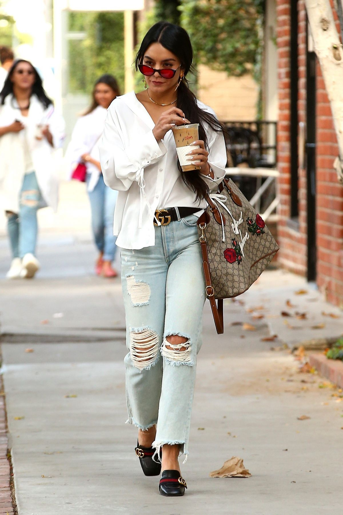 VANESSA HUDGENS in Ripped Jeans at Alfred Coffee in West Hollywood 05/15/2017