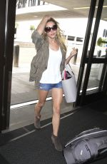 ASHLEY GREENE in Denim Shorts at LAX Airport in Los Angeles 06/23/2017