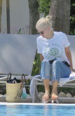 ASHLEY JAMES in Bikini at a Pool in Marbella 06/27/2017