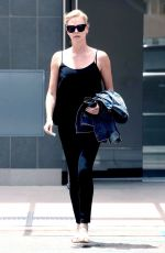CHARLIZE THERON Out and About in Beverly Hills 06/22/2017