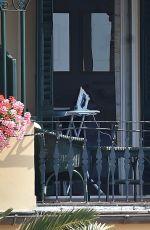 GILLIAN ANDERSON at Balcony of Her Hotel in Portofino 06/25/2017