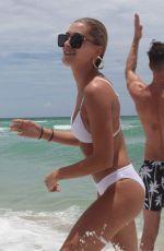 HAILEY BALDWIN in White Bikini on the Beach in Miami 06/12/2017