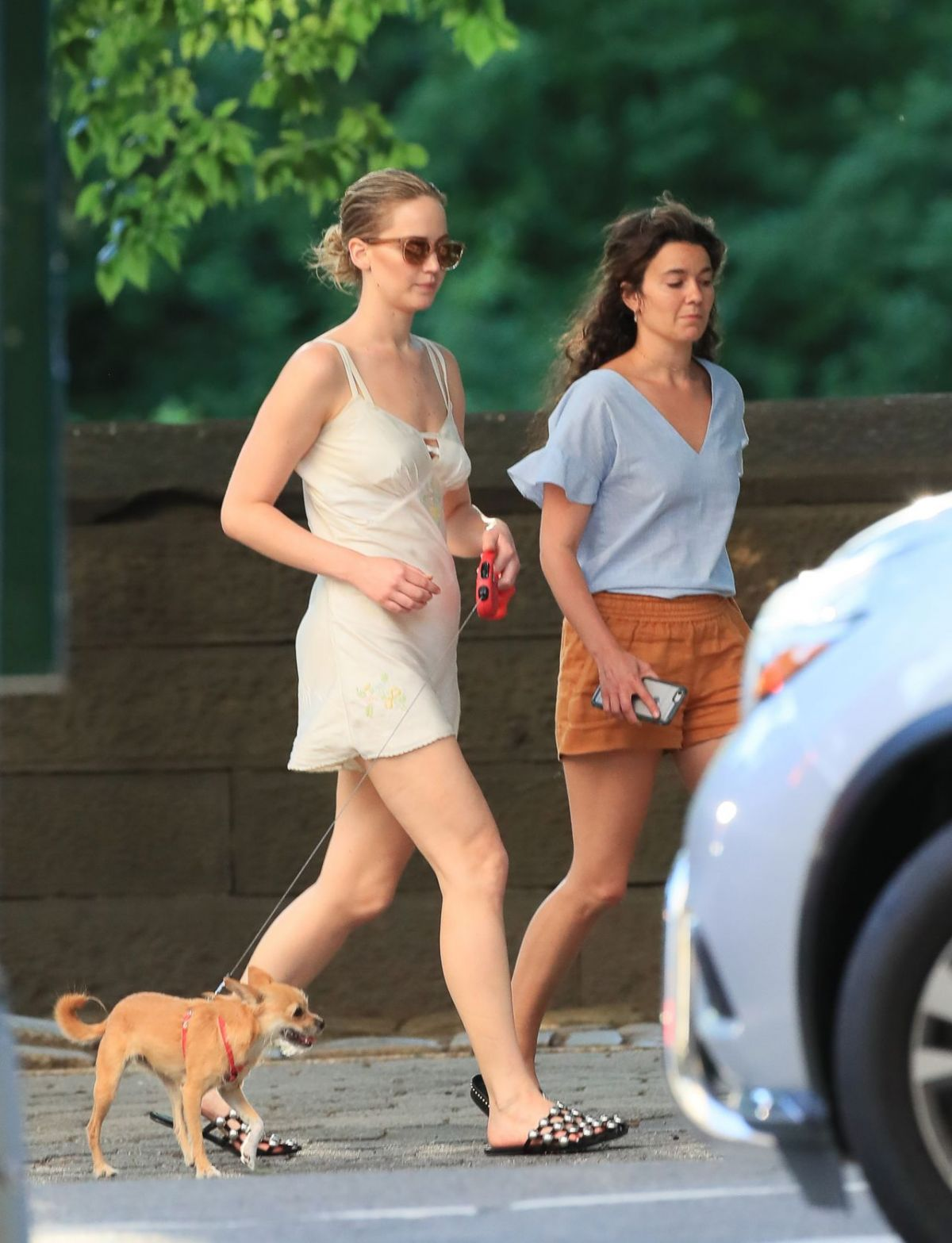 JENNIFER LAWRENCE Walks Her Dog Out in New York 06/15/2017