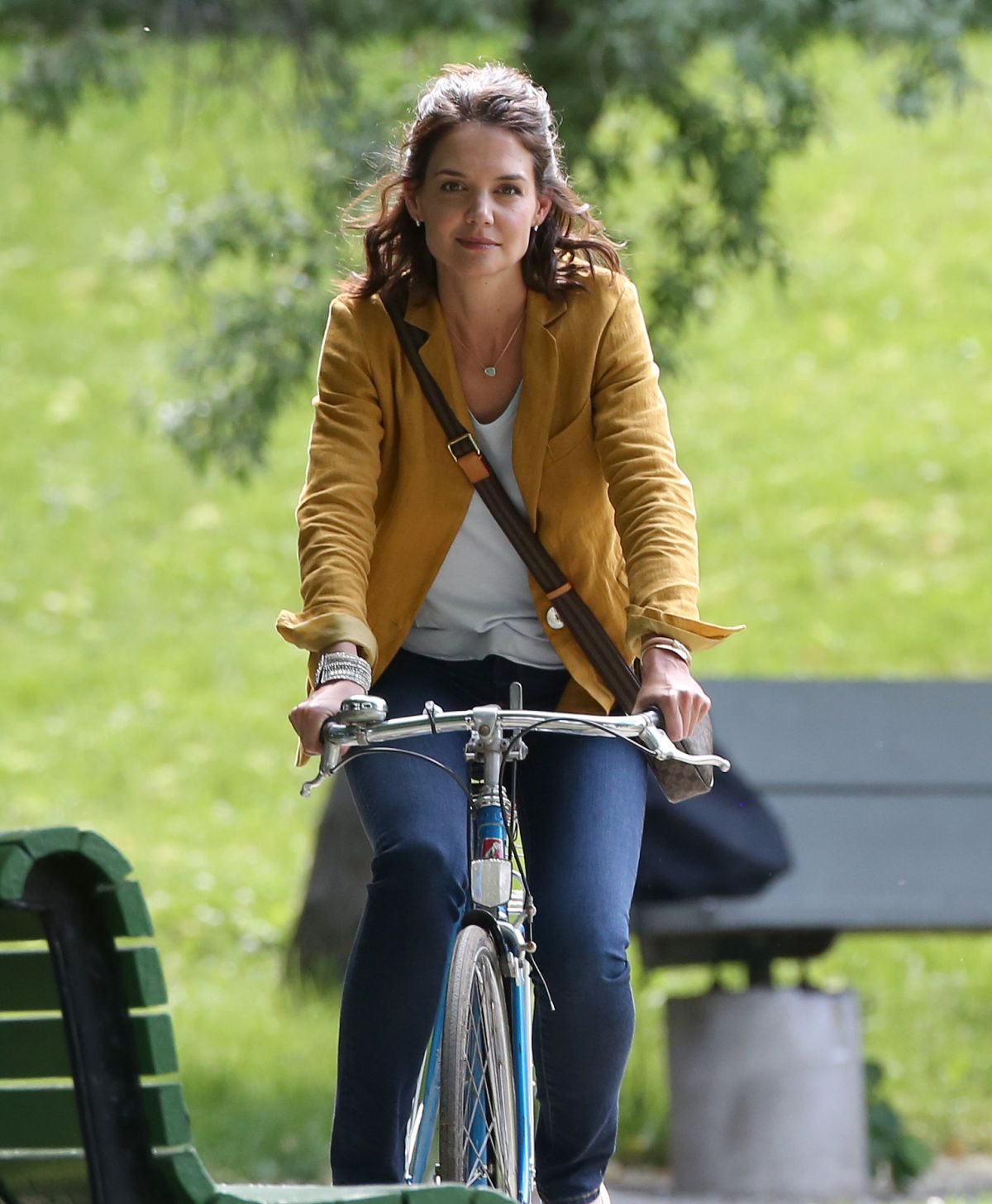 KATIE HOLMES Riding a Bike on the Set of The Gift in Montreal 06/22/2017