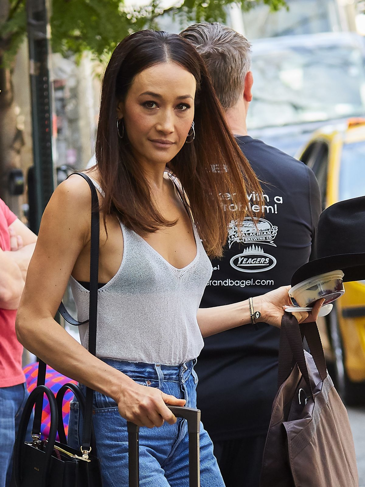 MAGGIE Q Leaves Her Ho...
