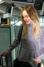 MARGOT ROBBIE Arrives at Heathrow Airport in London 06/01/2017
