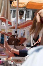 MICHELLE HUNZIKER in Bikini at a Beach in Varigotti 06/10/2017