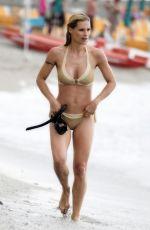MICHELLE HUNZIKER in Bikini at a Beach in Varigotti 06/22/2017