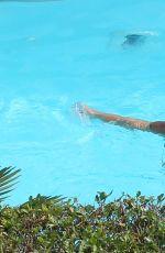 MICHELLE HUNZIKER in Swimsuit at a Pool in Bergamo 06/25/2017