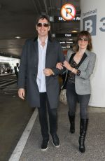 MILLA JOVOVICH at LAX Airport in Los Angeles 06/04/2017