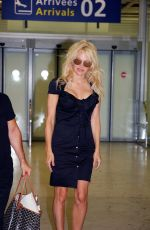 PAMELA ANDERSON at Orly Airport in Paris 06/19/2017