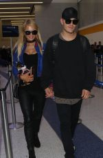 PARIS HILTON and Chris Zylka at LAX Airport in Los Angeles 06/08/2017