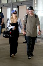PARIS HILTON and Chris Zylka at LAX Airport in Los Angeles 06/11/2017