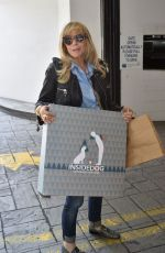 ROSANNA ARQUETTE Out for Shopping in Beverly Hills 06/01/2017