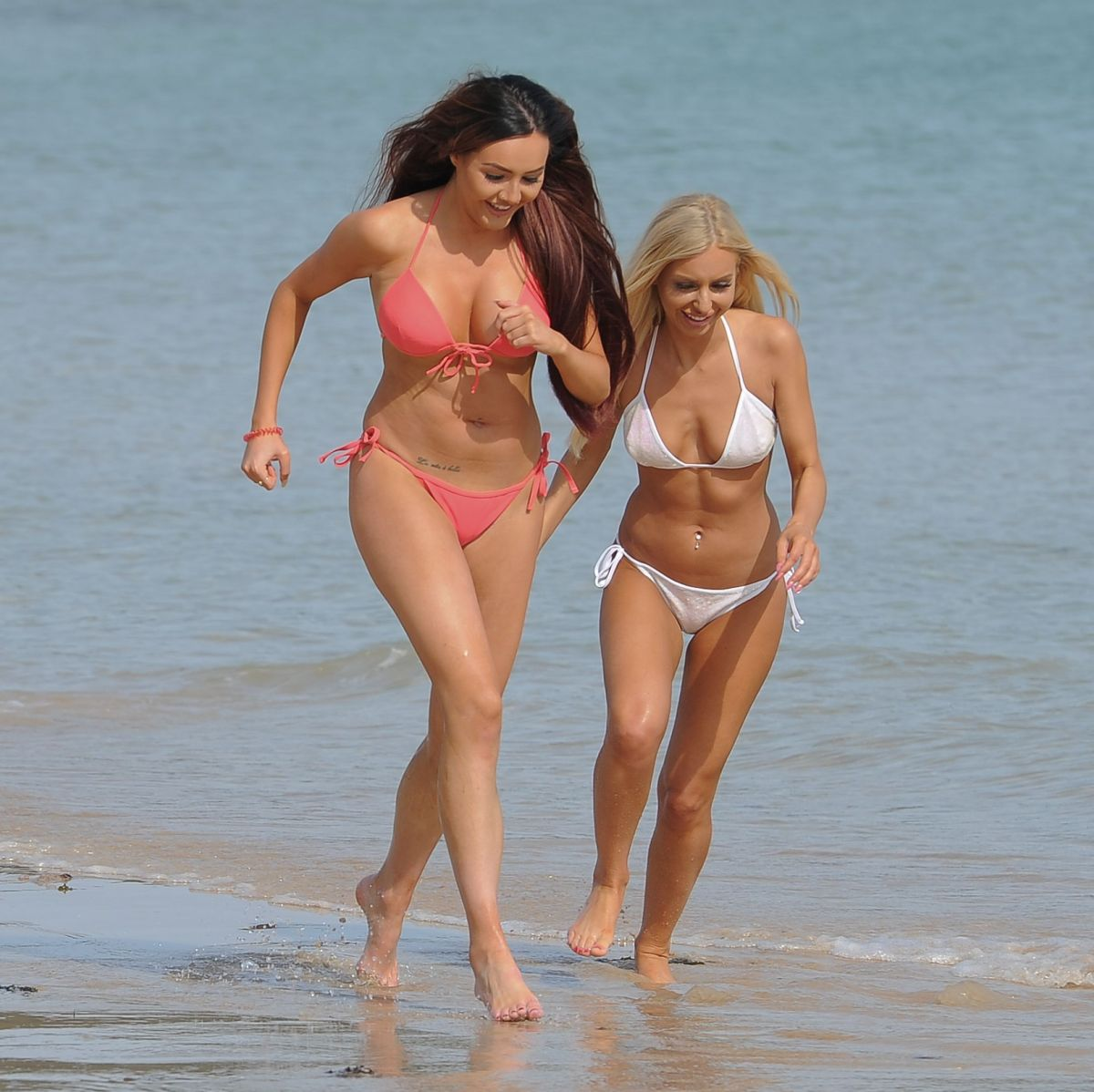 SARAH GOODHART and HOLLY RICKWOOD in Bikinis at a Beach in Ibiza 06/07/2017