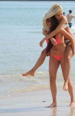 SARAH GOODHART and HOLLY RICKWOOD in Bikinis at a Beach in Ibiza 06/07/2017