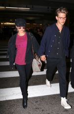 VANESSA HUDGENS and Austin Butler at LAX Airport in Los Angeles 06/26/2017