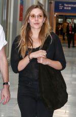 ELIZABETH OLSEN Arrives in Paris 07/02/2017