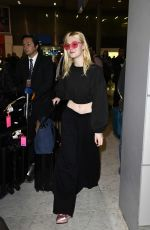 ELLE FANNING at Charles De Gaulle Airport in Paris 07/01/2017