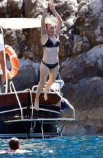 ELLIE GOULDING in Bikini at a Boat in Capri 07/04/2017