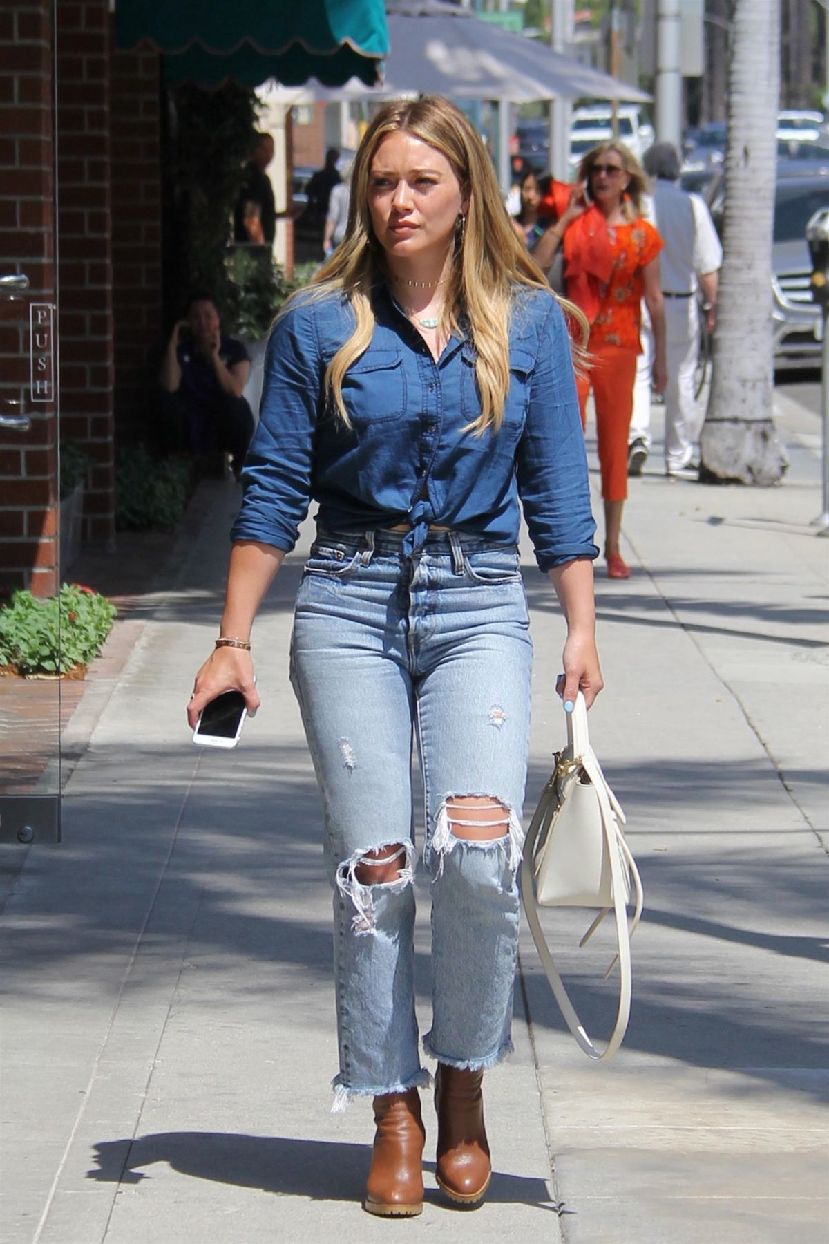 HILARY DUFF in Ripped Jeans Out and About in Beverly Hills 07/28 ...