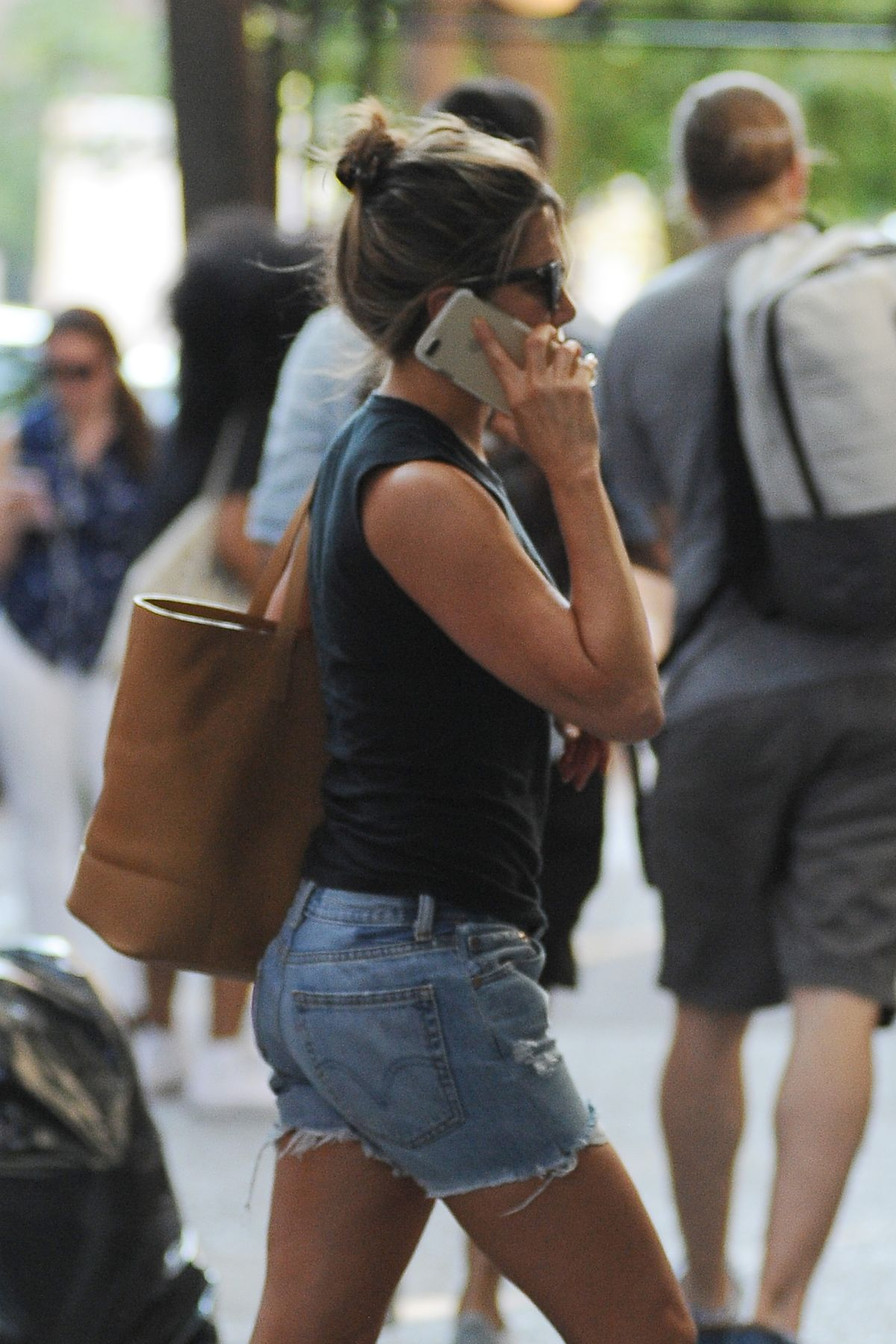 JENNIFER ANISTON Talking on Her Phone Out in New York 07/18/2017