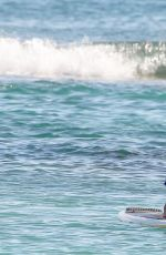 JESSICA ALBA Paddleboarding on Vacation in Honolulu 07/14/2017