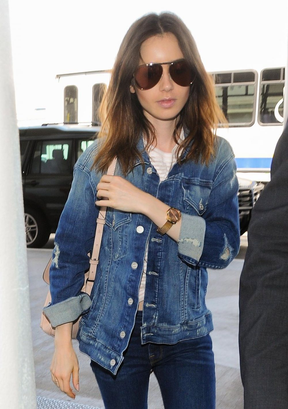 LILY COLLINS at Los Angeles International Airport 07/13/2017