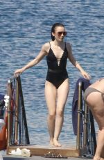 LILY COLLINS in Swimsuit at a Beach in Ischia 07/15/2017