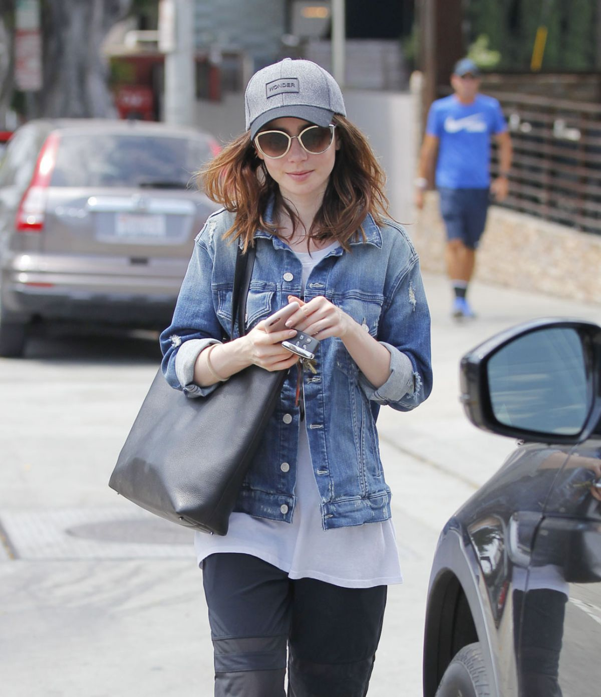LILY COLLINS Leaves a Salon in Beverly Hills 07/09/2017