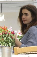 LILY COLLINS Out and About in Ischia 07/18/2017