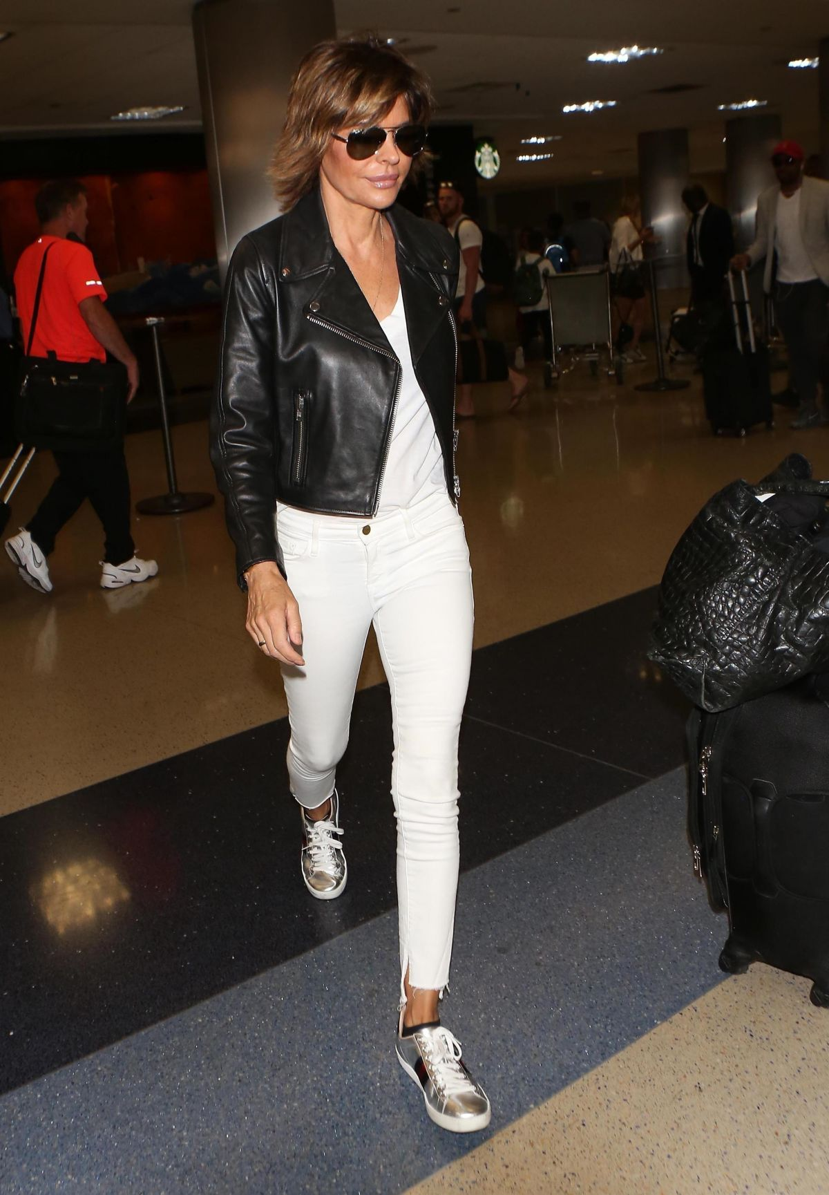 LISA RINNA at LAX Airport in Los Angeles 07/08/2017