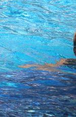 MICHELLE HUNZIKER in Bikini at a Pool in Milano Marittima 07/03/2017