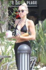 MILEY CYRUS in Bikini Top Out in Malibu 07/25/2017