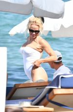 PAMELA ANDERSON in Swimsuit at a Beach in St Tropez 07/18/2017