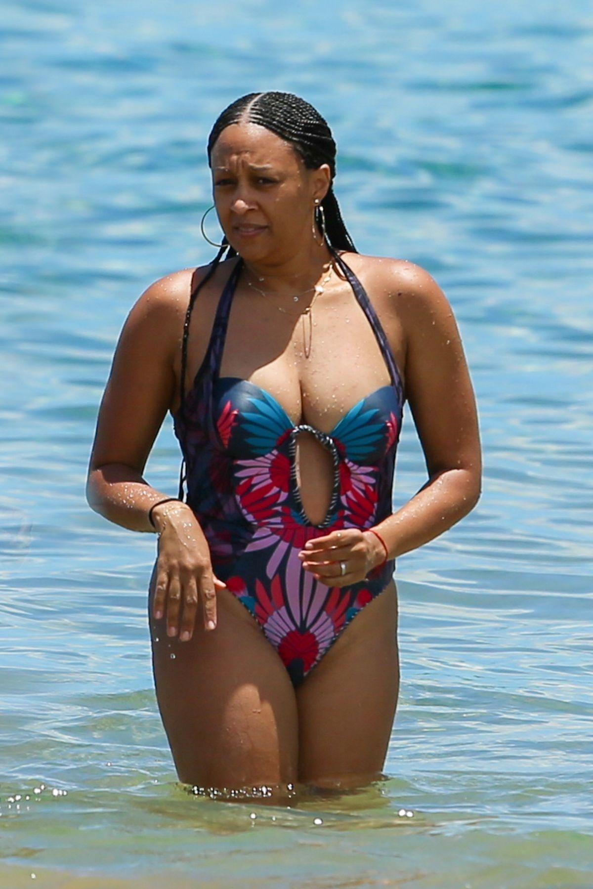 TIA MOWRY in Swimsuit on the Beach in Hawaii 07/09/2017