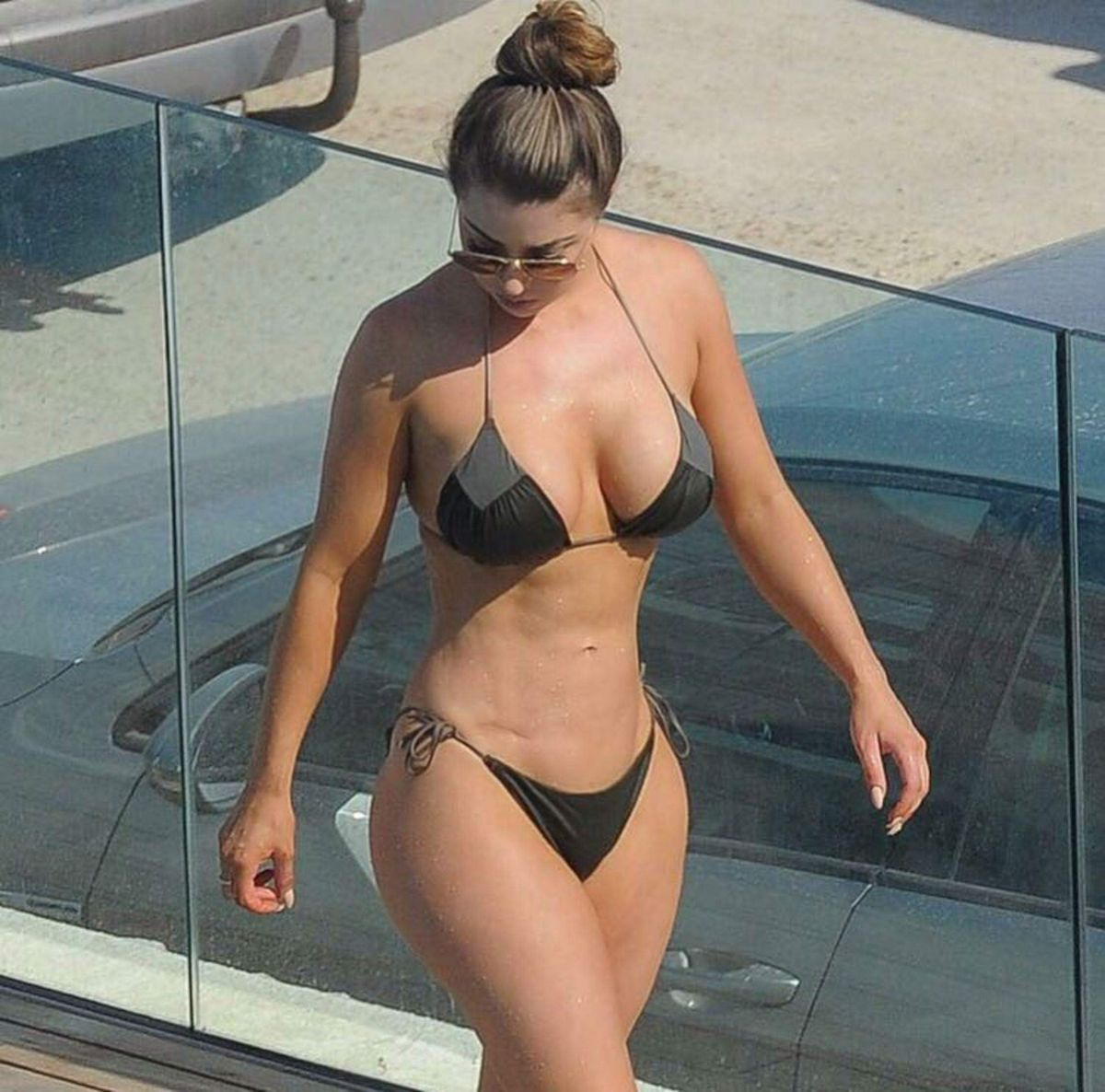 ABIGAIL CLARKE in Bikini at a Pool in Marbella 08/19/2017