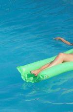 ABIGAIL CLARKE in Bikini at a Pool in Marbella 08/19/2017